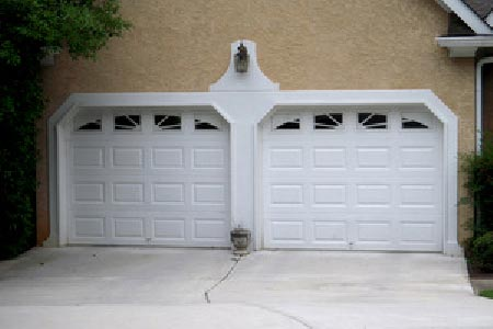 Two white garage doors